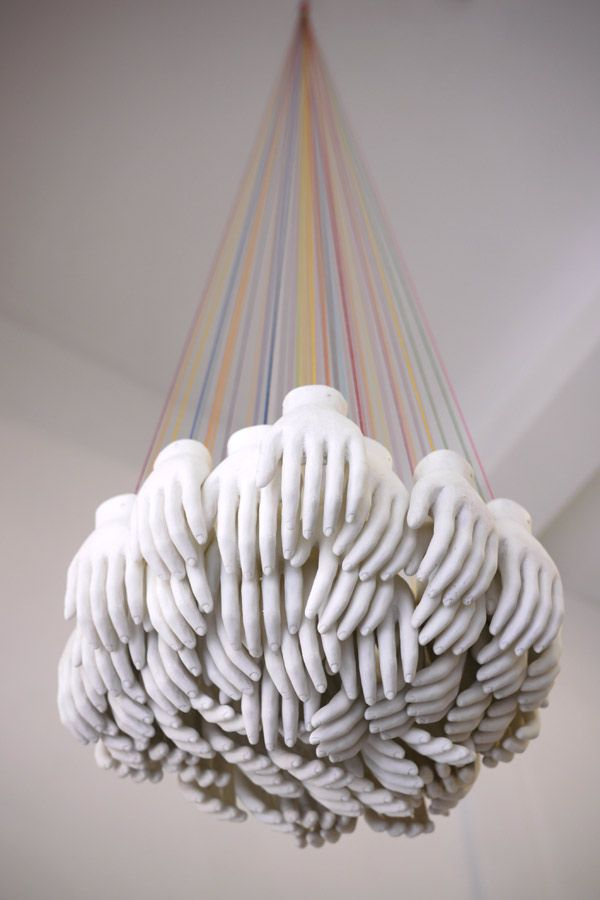 Sculpture by Clark Goolsby - This would even more amazing if they were gold or silver and the fingertips had pin lights in them, making this a chandelier.