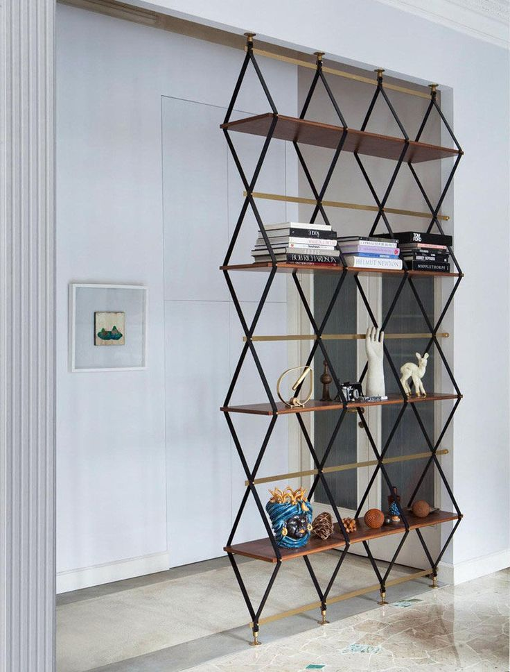 This multi-functional design is both a floor-to-ceiling shelf and a room divider.