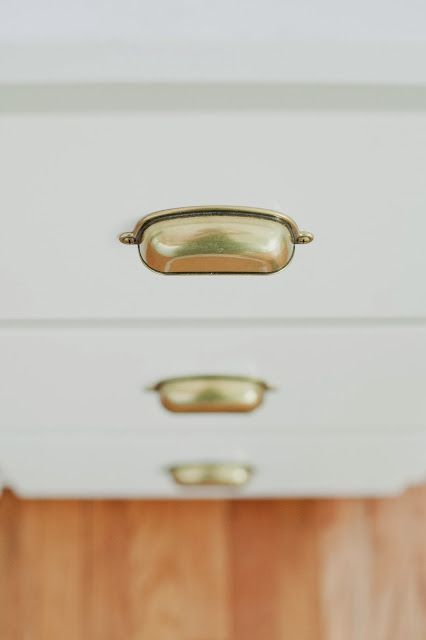 Brass cup pulls. Source: Home Depot Martha Stewart Living Bedford 3 in. Canopy Cup Cabinet Hardware Pull