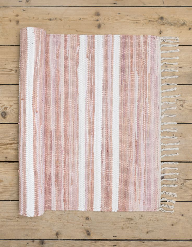 Our pink and white striped Saga rug is perfect for a child's bedroom and is 100% machine washable! Gifts, rugs and inspiration for bedrooms and home decoration from Skandihome.com