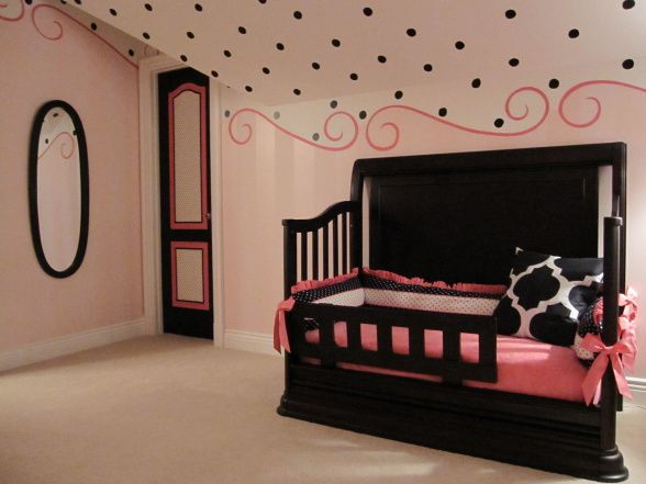 in love with the walls/ceiling..especially the polka dots on the ceiling!!  The bed/bedding I would change....