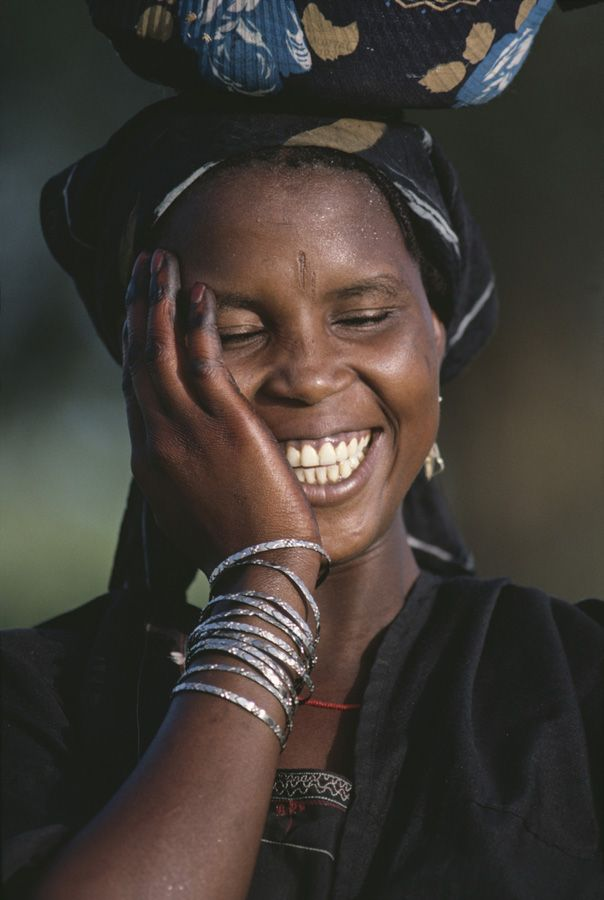 Africa | Woman smiling in Mali. Photo credit: Steve McCurry. — #MindBodySpirit. Brought to you by SunGoddess Magazine: Igniting the Powerful Goddess WIthin http://sungoddessmagazine.com