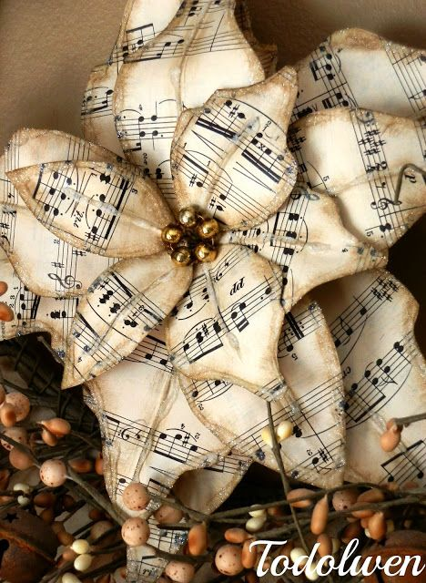 Poinsettias - made from vintage sheet music, mercury glass beads, glitter, wire and glue. How pretty is this!