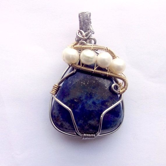Hey, I found this really awesome Etsy listing at https://www.etsy.com/ca/listing/218533337/lapis-lazuli-pendant-pearl-wire-wrapped