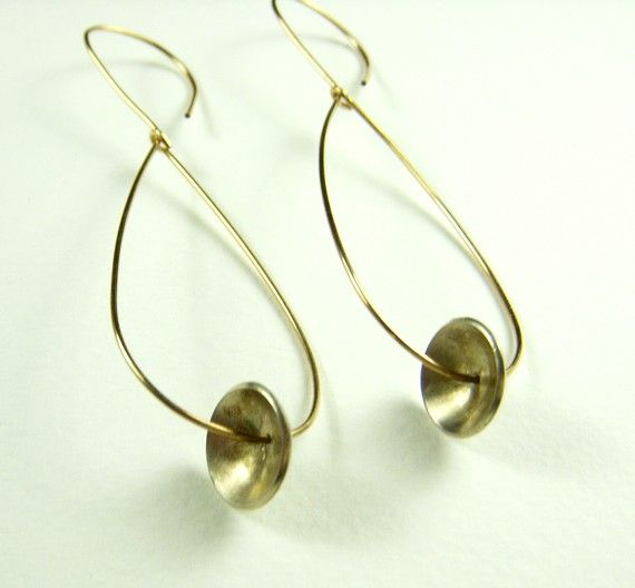 14K Gold filled wire earrings with silver discs.  Discs are handcut,domed and brushed for matte finish.  Earrings are 2.75 inches long,.75 inches wide. $55