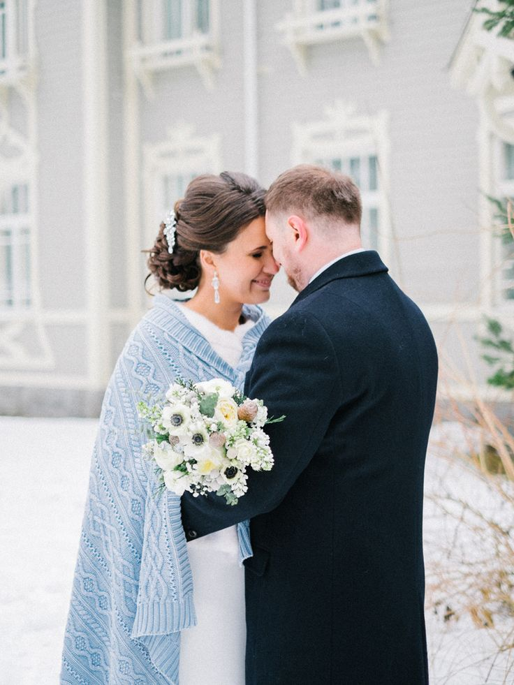 Bride and groom in the snow , Blue Winter Wedding - Read more Real Winter Weddings | fabmood.com #winterwedding