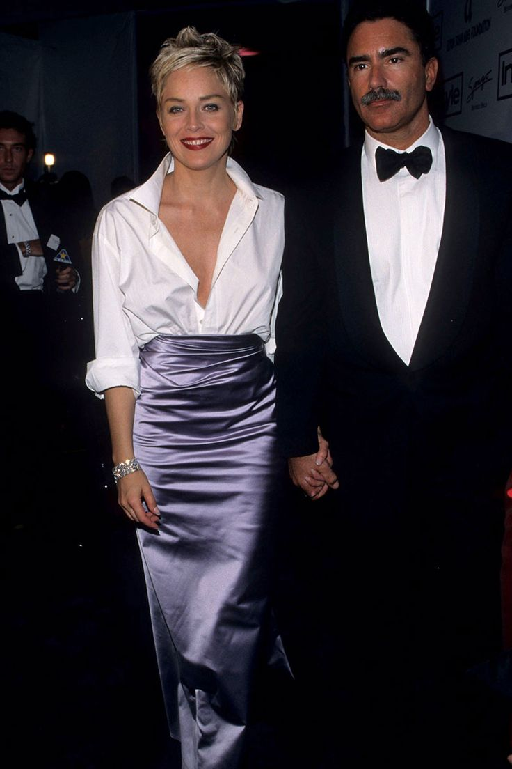Sharon Stone paired her husband's white button down (GAP) with a purple satin Vera Wang skirt to the Oscars.