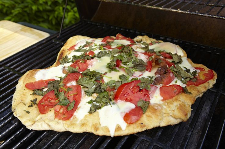 Slide pizza onto cutting board and serve. (You may have to guard it from eager taste  testers as you carry it to the table.)