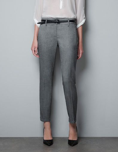 Slight stretch tailored grey trousers.
