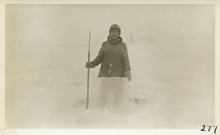 Pitseolak's father, Ottochie, in Idjirituq, c. 1921–22; the ice block will be used as a window in an igloo. Photograph by Donald Baxter MacMillan.