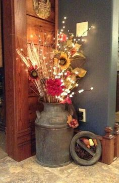 like the idea with a big vase and prettier flowers for year round. Make it more contemporary/chic
