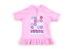 """Camiseta tipo """"rashguard"""" para bebe niña, en color rosado."""