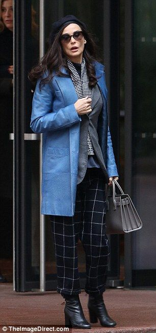 Demi Moore cut a striking figure in a cornflower-blue coat and navy plaid trousers while filming scenes for her new movie Blind in NYC