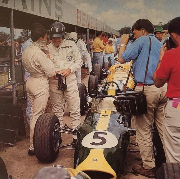 Jim Clark and Graham Hill swap notes prior to the start of the 1967 Australian Grand Prix, Warwick Farm, Sydney. It would be a good season for them both…