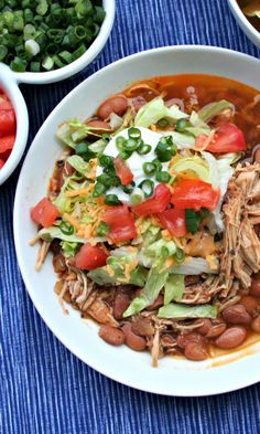Skinny Slow Cooker Burrito Bowls. Chicken and Pinto Beans all made at the same time in your Slow Cooker!