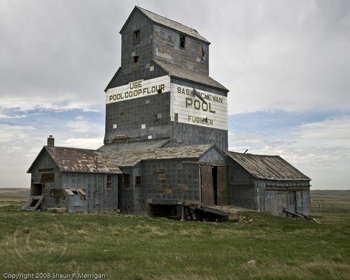 CANADA | Abandoned wooden grain elevator at Fusilier, Saskatchewan | Photo by Shaun P. Merrigan, (c) 2008