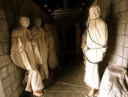 Shrouded bodies along the walls.  Scare opportunity! lol image some as dummys and some as real people oh boy that would scare the crud out of someone