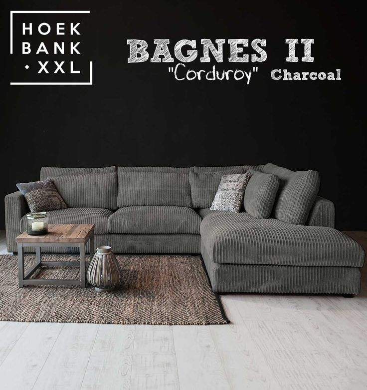 Hoekbank Bagnes II in de kleur donker grijs. Het is een grote moderne hoekbank met losse kussens en een longchair rechts. De stof is in verschillende kleuren verkrijgbaar. De hoekbank is configureerbaar zodat het perfect in uw woonkamer staat.   HoekbankXXL