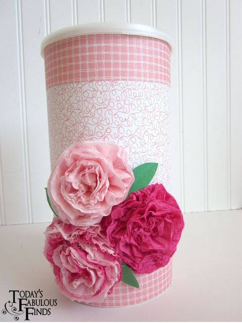 Oatmeal can wrapped in scrapbook paper with crete paper flowers...cute hostess gift or holiday gift with baked goods inside!!