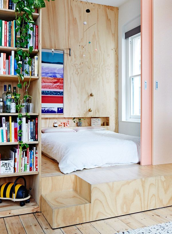 bedroom on a plywood platform // tall ceilings Love how you can close it off with a sliding door. Perfect for a one room apartment.