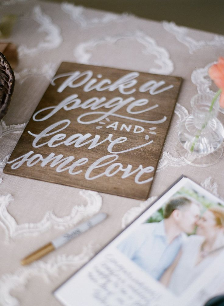 "Wedding guestbook table sign by @ashleybuzzy ""Pick a page and leave some love"""
