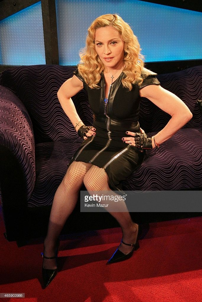 Madonna poses as she appears on The Howard Stern Show on Howard Stern's exclusive SiriusXM Channel Howard 100 at SiriusXM Studios on March 11, 2015 in New York City.