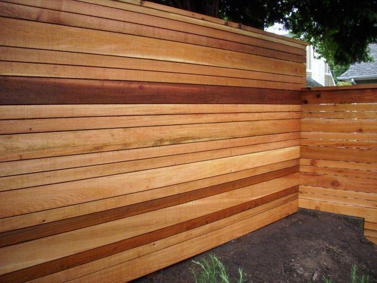 Multi-tone Natural Colored Horizontal Fence. Variable Slat