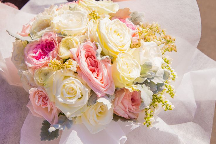Kylie & Steven's Blooming Brilliant Wedding at The Sebel Windsor soft pink, ivory, and green bouquets including roses, ranunculus, dusty miller and pieris.