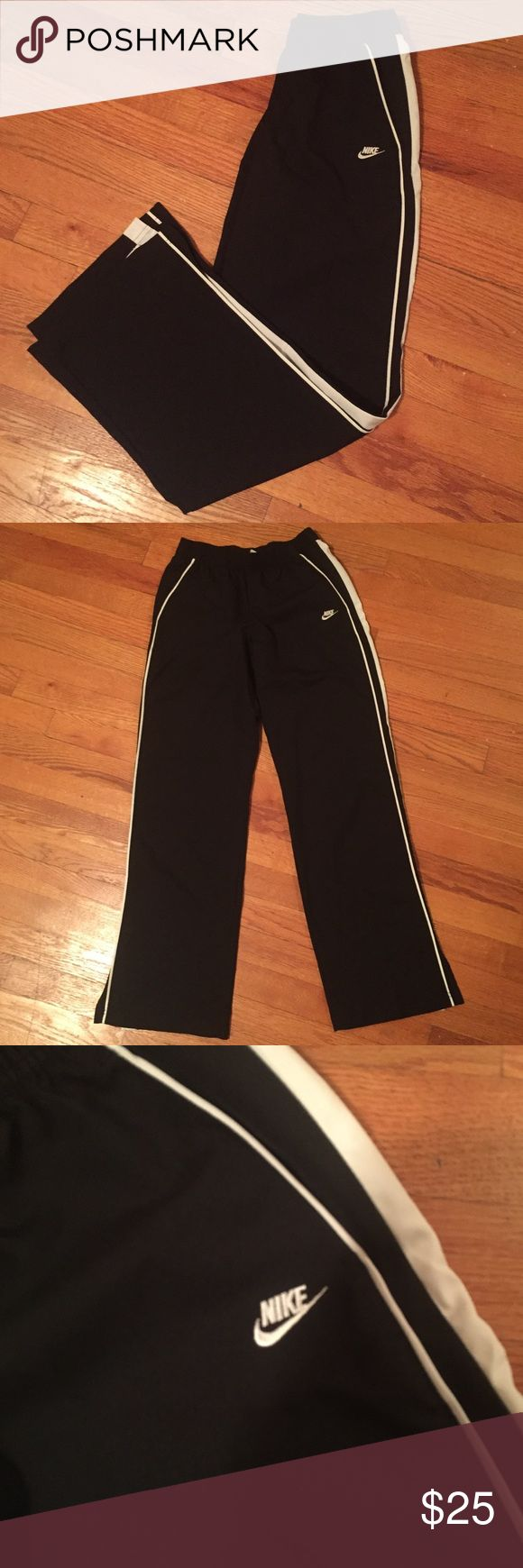 Black with white stripe Nike track pants These nike track pants are black with white stripes down the side. There are pockets and a slight slit at the bottom of each pant leg for air. Lightly worn and in great shape Nike Pants Track Pants & Joggers