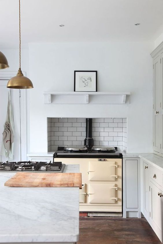 marble kitchen with vintage style stove