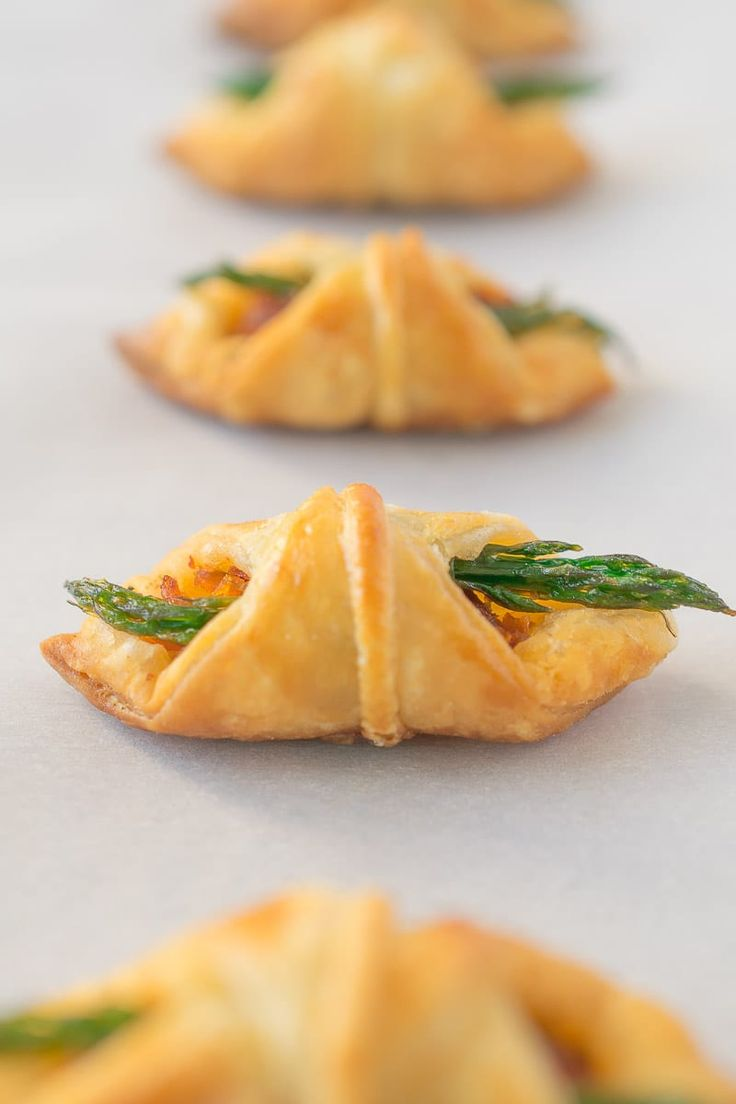 Asparagus and sun-dried tomato pesto wrapped in puff pastry. Easy, but impressive appetizer bites.