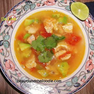 Sopa De Lima is a Paleo Yucatan delight. A soup with lime, chicken, chilies, garlic, avocado, and cilantro. Gluten free and grain free. No refined ingredients. Low carb too.