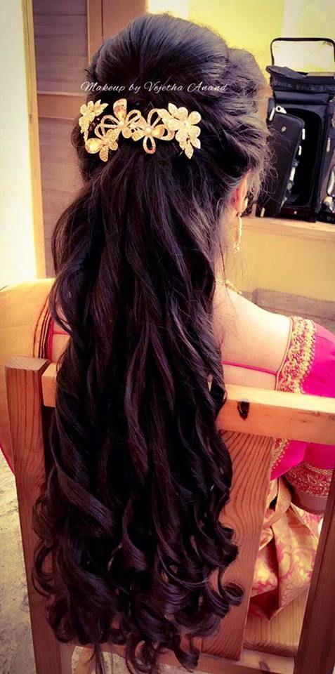 Indian bride's reception hairstyle by Swank Studio. Bridal updo. Curls. Saree Blouse Design. Hair Accessories. Tamil bride. Telugu bride. Kannada bride. Hindu bride. Malayalee bride. Find us at https://www.facebook.com/SwankStudioBangalore