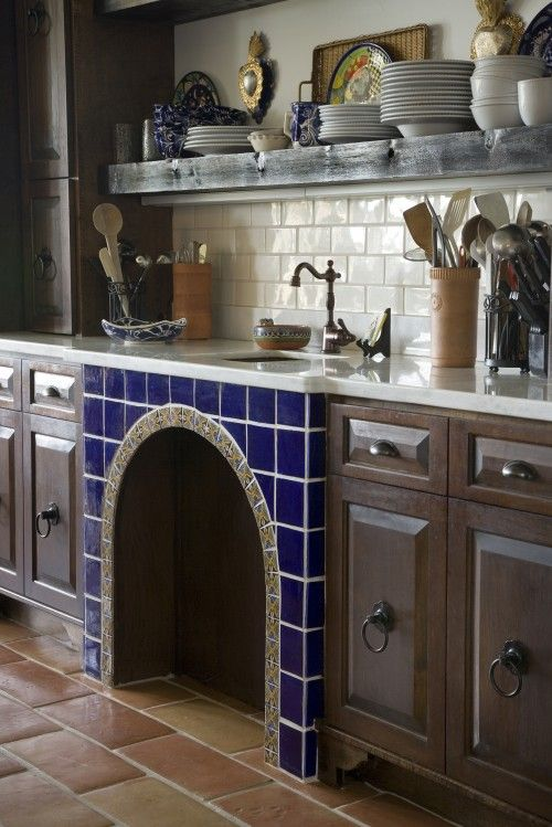 all my fav elements. spanish tile, zinc, dark wood, white subway tile.