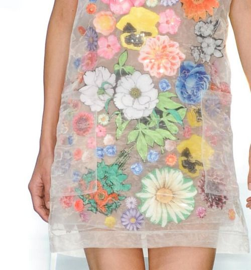 Cut out floral fabrics fused between panels of sheer material.