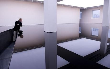 Richard Wilson's 20:50 installation, Saatchi Gallery, London. This waist-high reservoir is filled with sump oil, with a walkway out to the middle of the reflective pool. Truly one of the most amazing installations I've experienced.