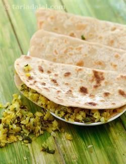 Cabbage and dal paratha is a brilliant combination of cereals, pulses and vegetables. This balanced meal can be made more nutritious by replacing half the wheat flour with soya flour or nachni flour. You are sure to enjoy the fine balance in this paratha with the softness of dal dotted with crisp slivers of cabbage and aromatic ingredients like fennel and mint.