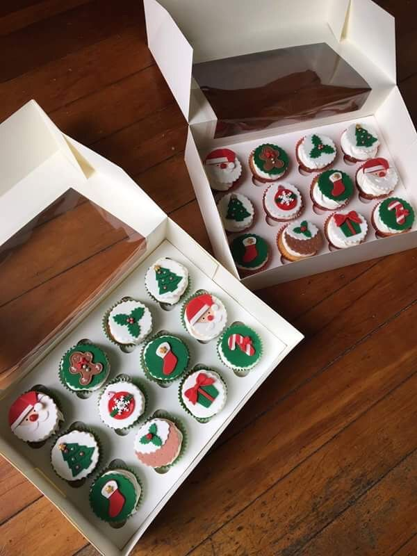 Christmas cupcakes! Santa, Christmas tree, ball, candy cane, holly, stocking, presents and santa!  Check out my page https://www.facebook.com/frosted.cupcakes.invercargill/