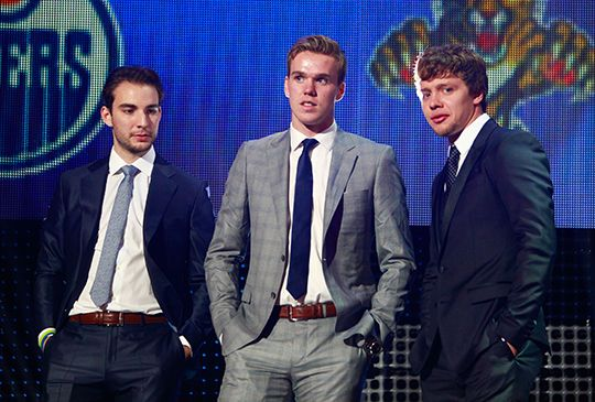 Shayne Gostisbehere, Connor McDavid and Artemi Panarin stand onstage during the 2016 NHL Awards.