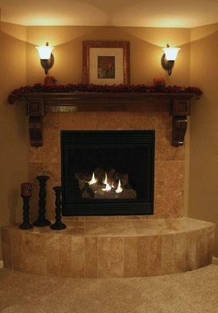 corner fireplace mantels | ... decorated corner electric fireplace tile massive mantel wall sconces