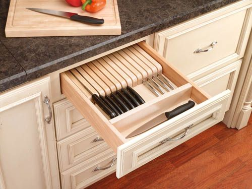 """Rev-A-Shelf 4WKB-1   Rev-A-Shelf's unique 4WKB-1 Knife Block Tray Insert is out of the box ready at 18-1/2"""" x 22"""" providing 19 slots to store knives and has a separate compartment for other utensils. The unique design provides more storage then a traditional Knife Block and with it's simple drop-in installation valuable counter top space is available to use immediately."""