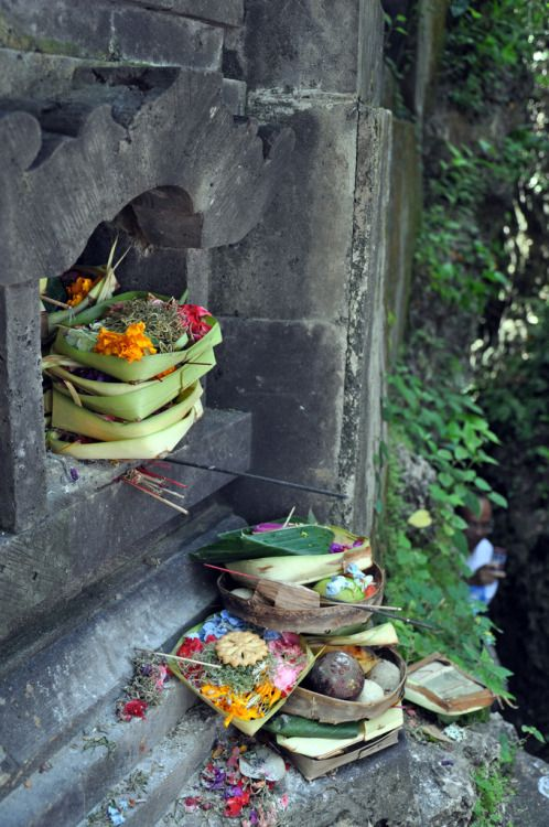 Here in this picture taken in Bali are objects that symbolize offerings to god. This is a ritual that has been practiced for centuries and gives sacred meaning to these objects.