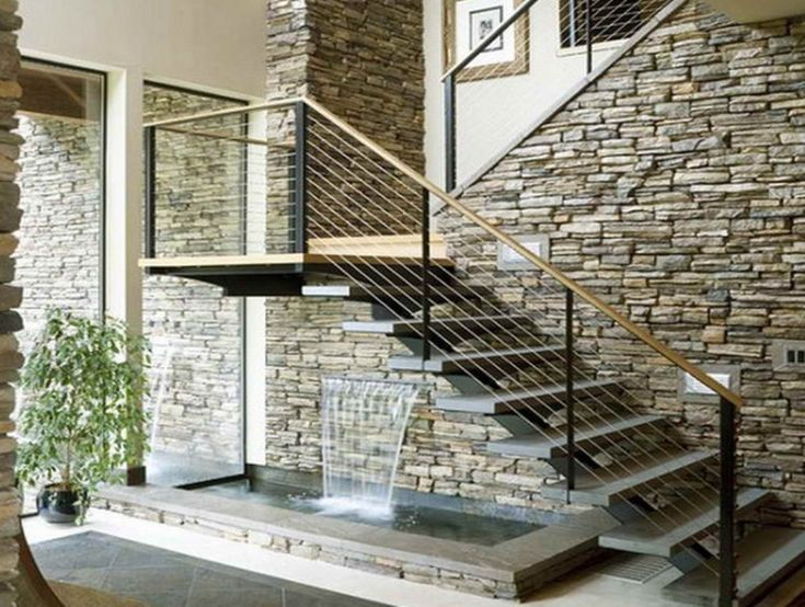decorative stone wall decor with contemporary metal staircase and cute indoor waterfall design indoor waterfall - Interior Stone Wall Designs