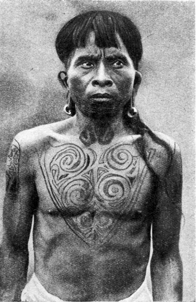 "Borneo | Ukits of the Rejang tattoo extensively. A bold hook pattern covers the chest, and a pattern known as the lizard adorns the sides of the shoulders. They wear brass earrings. | Image from the 1922 publication ""Peoples of All Nations"" Chalres Hose, Author"