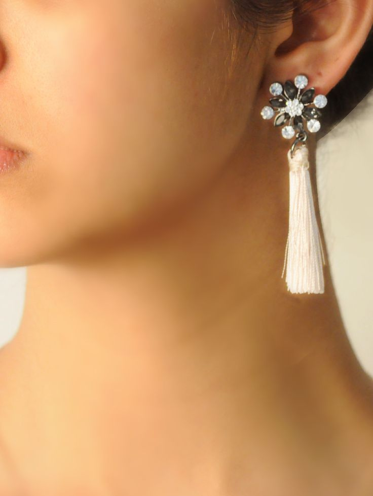 Farrah Tassel drops -  INR 1,499 -  These tassel earrings feature a glossy blonde tassel, the top part of the earring is a crystal stud that uplifts the colour of the earring. Its a great accessory that transcends easily from day to night