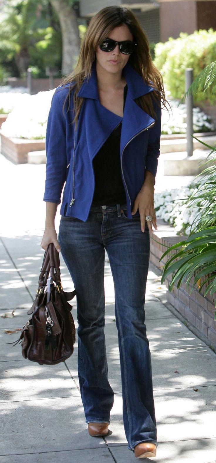 Blue jacket, jeans, brown shoes, black shirt