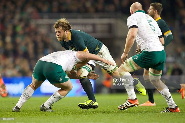 Duane Vermeulen of South Africa is tackled by Jack McGrath of Ireland during the 2014 Guinness...
