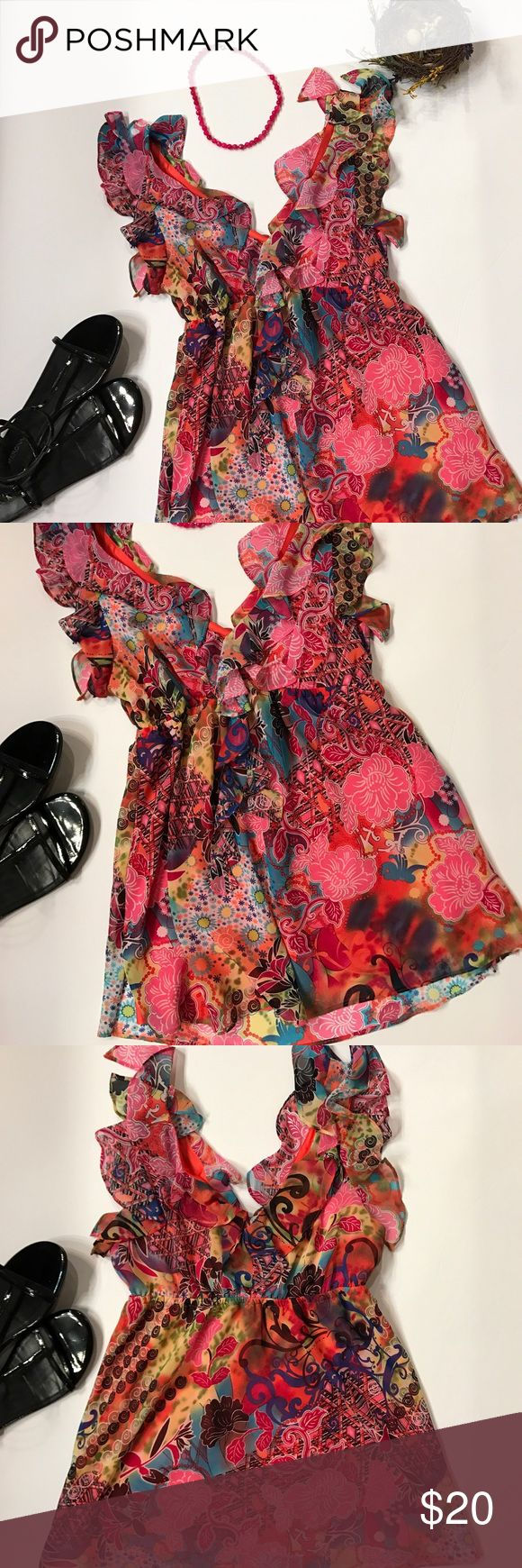 Bisou Bisou v-neck sleeveless print top Brighten up the room wearing this flirty v-neck top w/ ruffles from shoulders to underarms and along neckline in front and back. Pull over style w/elastic under bodice for flattering look. Shell & lining are 100% polyester Bisou Bisou Tops Blouses