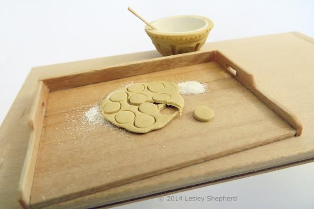 Instructions for making dollhouse scale miniatures of a traditional 3 sided pastry board.