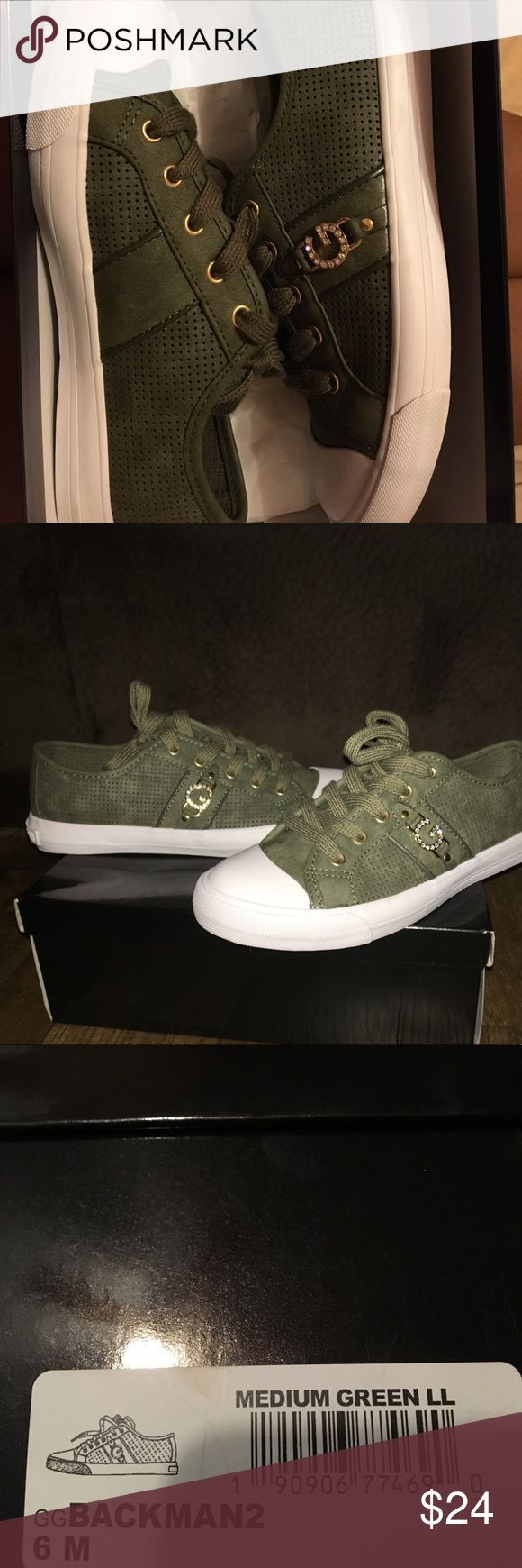 Olive green G By Guess shoes They are an olive green with gold accents G by Guess Shoes Sneakers